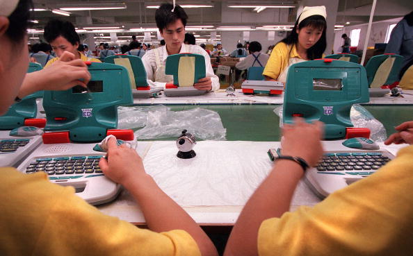 Assembly line workers at a Billion International