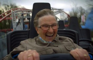 old-woman-really-really-enjoys-first-roller-coaster-ride-2596377