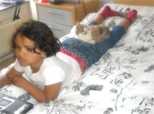 girl saving cat