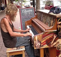 homeless man plays piano 1