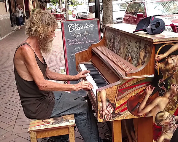 homeless man plays piano 1
