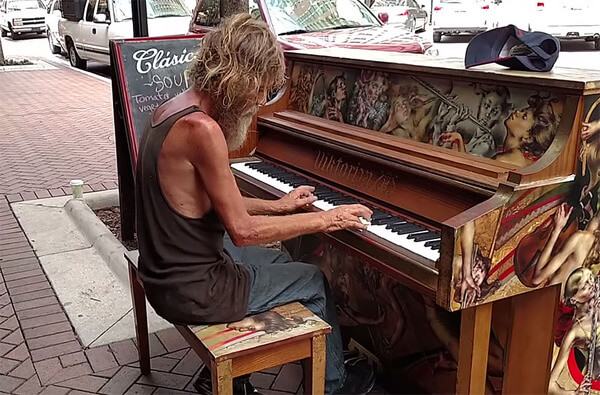homeless man plays piano 3