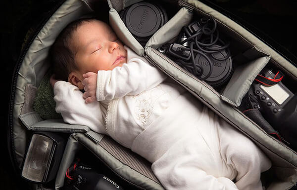 portraits of babies in camera bags 1