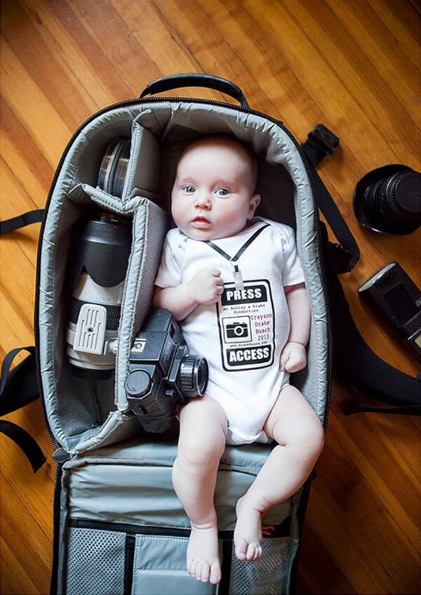 portraits of babies in camera bags 3