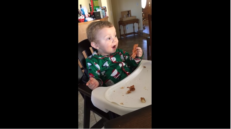 baby eating bacon