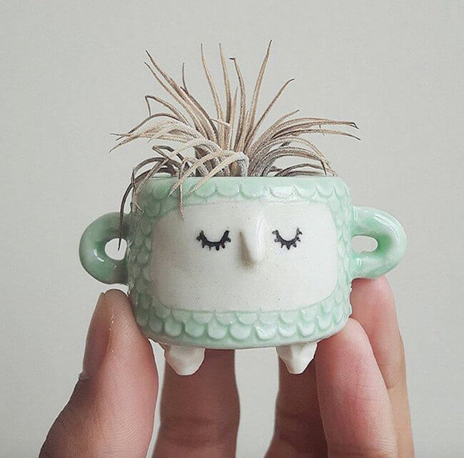 Cute ceramic face pots given a cool hairdo when you add a for Cute pottery designs