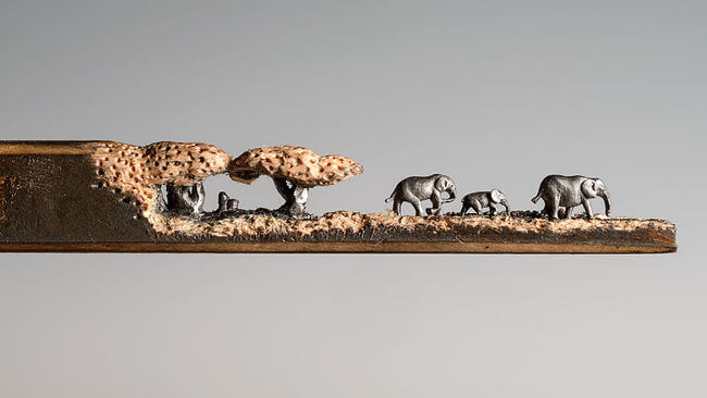 Elephants carved Into A Pencil 1