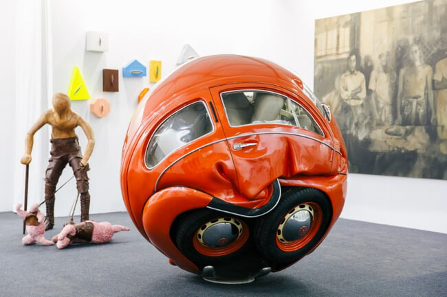 Cars Compressed into Perfect Spheres 3