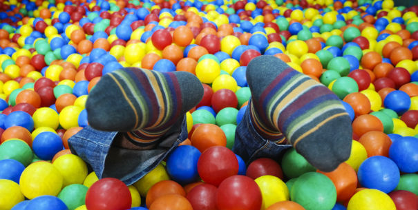 awesome photographs - jumping into a pool of balls