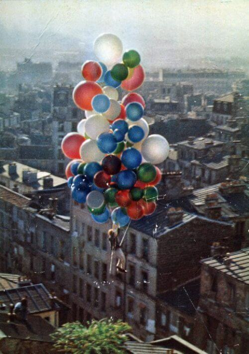 insane pictures - man flying with lots of balloons