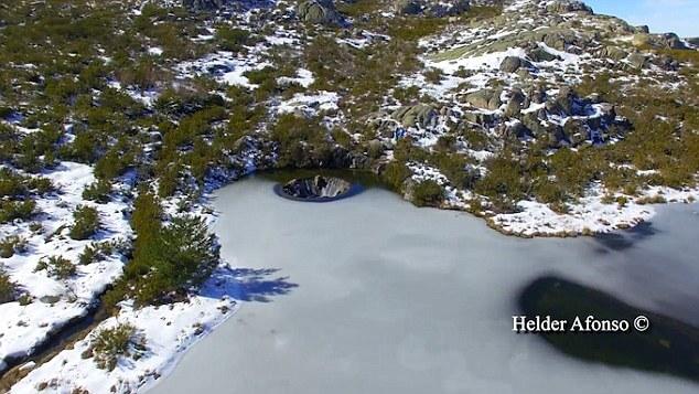 waterfall inside lake portugal (1)