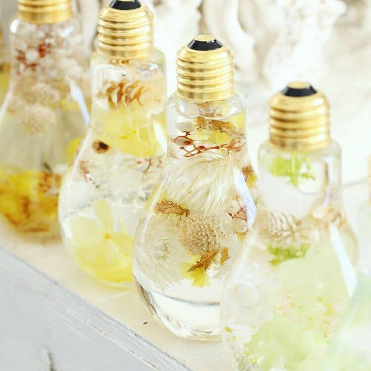 beautiful flowers inside light bulbs suspended in time look like luxury jewels