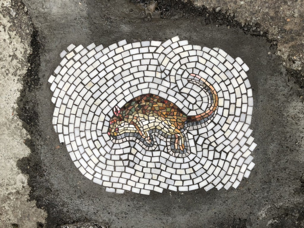 Turning potholes into mosaics serves both as a solution and an art form