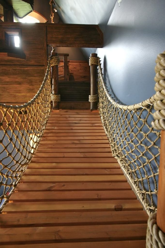 rope bridge inside the room themed like a pirate ship